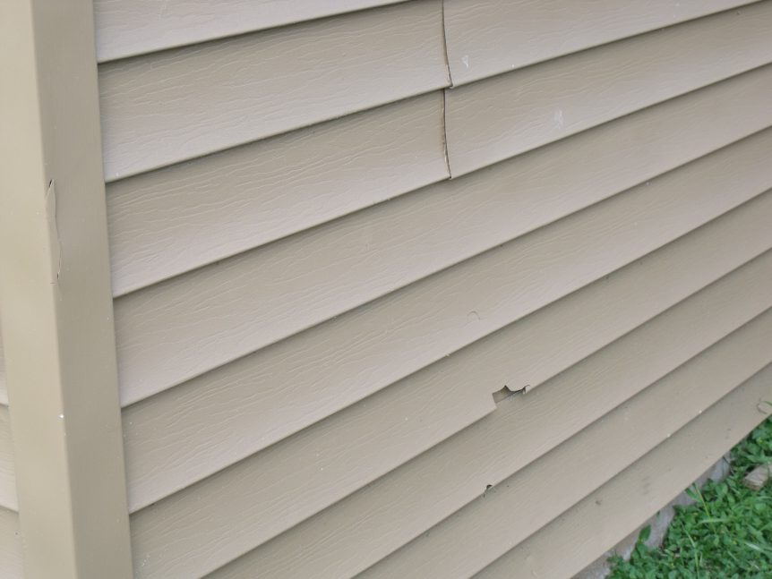 brittle damaged vinyl siding
