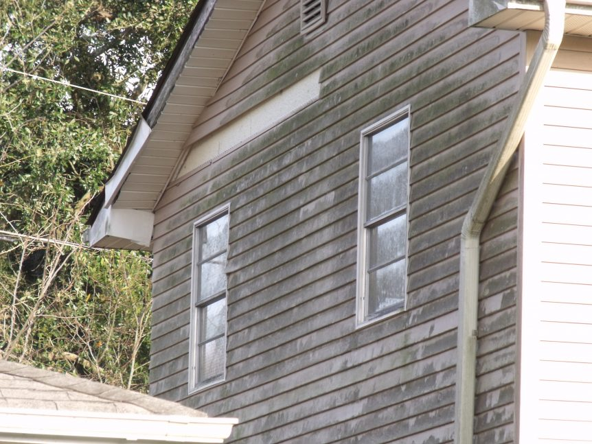 Vinyl siding that has stained