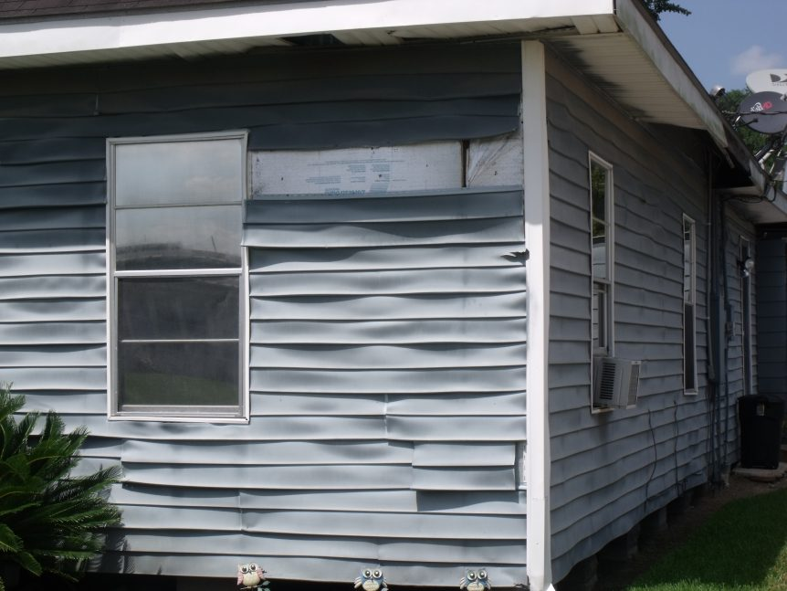 The sun has caused this vinyl siding to melt and warp