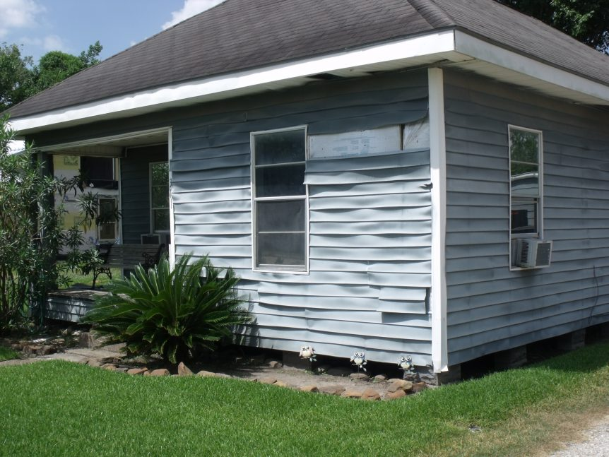 vinyl siding that has wrinkled and waved with normal heat from the sun